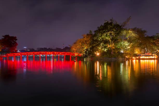 Red bridge on Hoan Kiem Lake stock photo