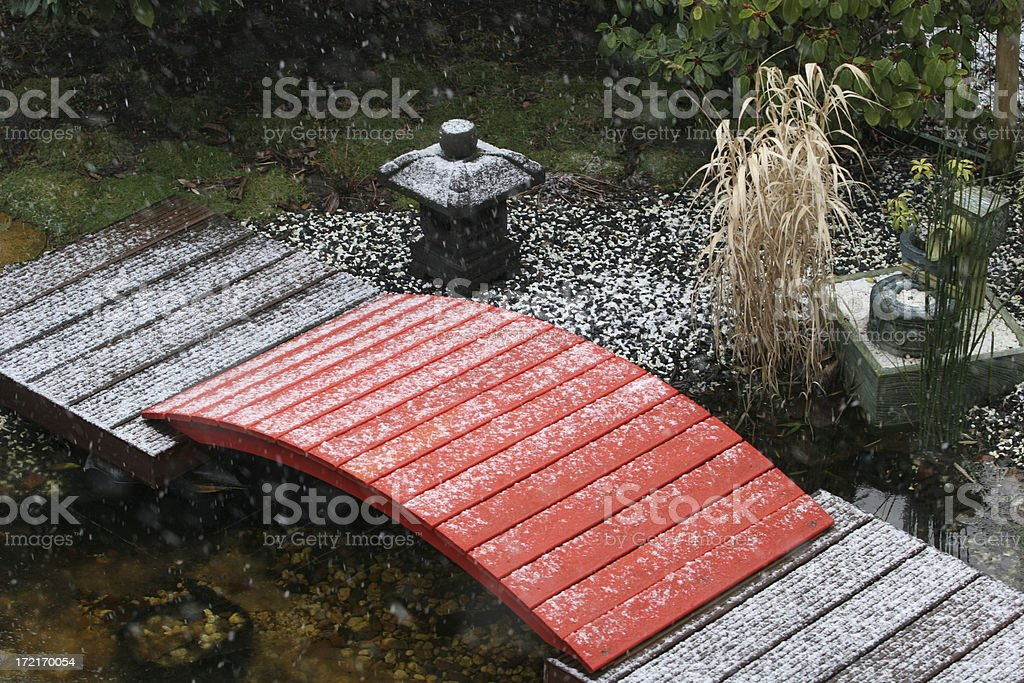 Red bridge with pond and snow stock photo