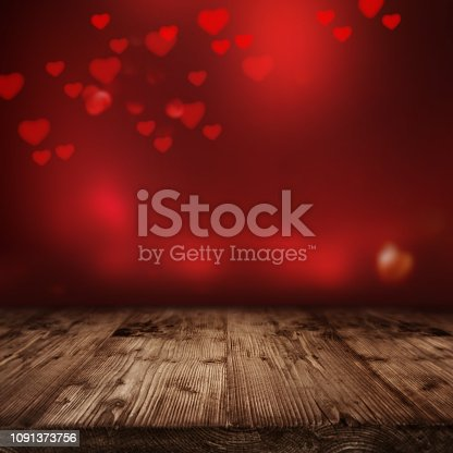 Wooden stage in front of red bright valentines background with hearts