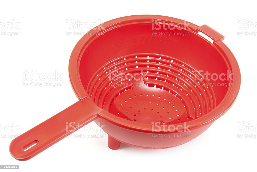Red brilliant plastic colander royalty-free stock photo
