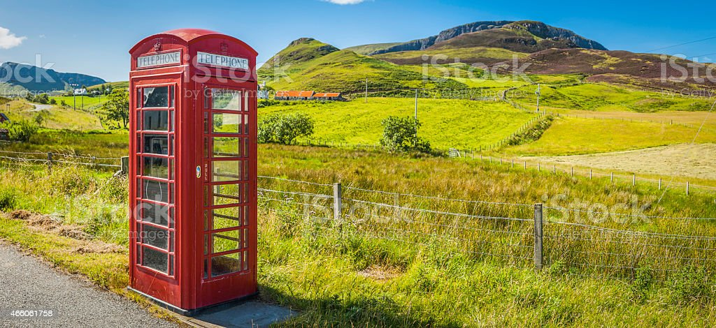 Red British phone box in green rural landscape Highlands Scotland stock photo