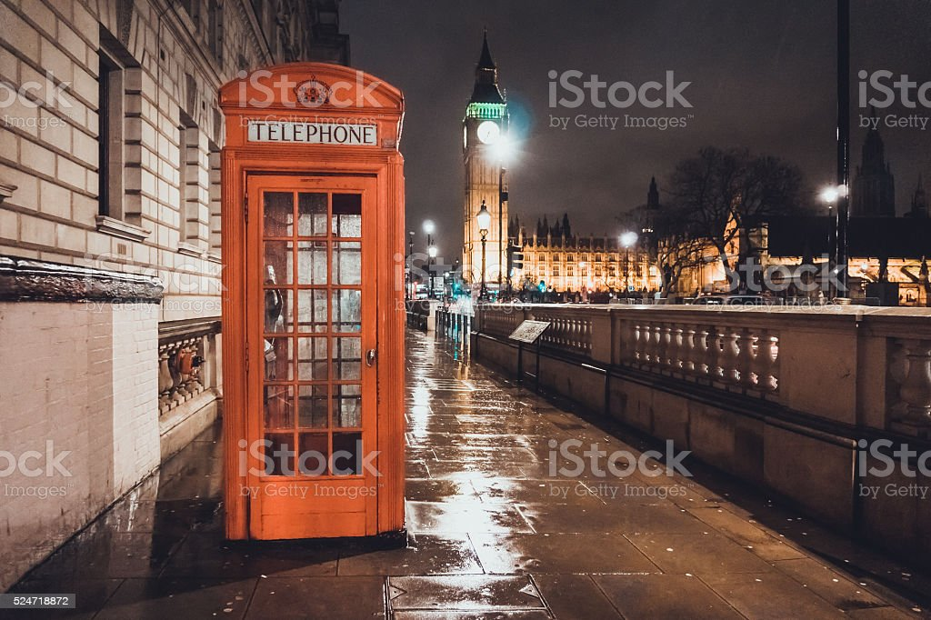 Red British Telephone Booth in London stock photo