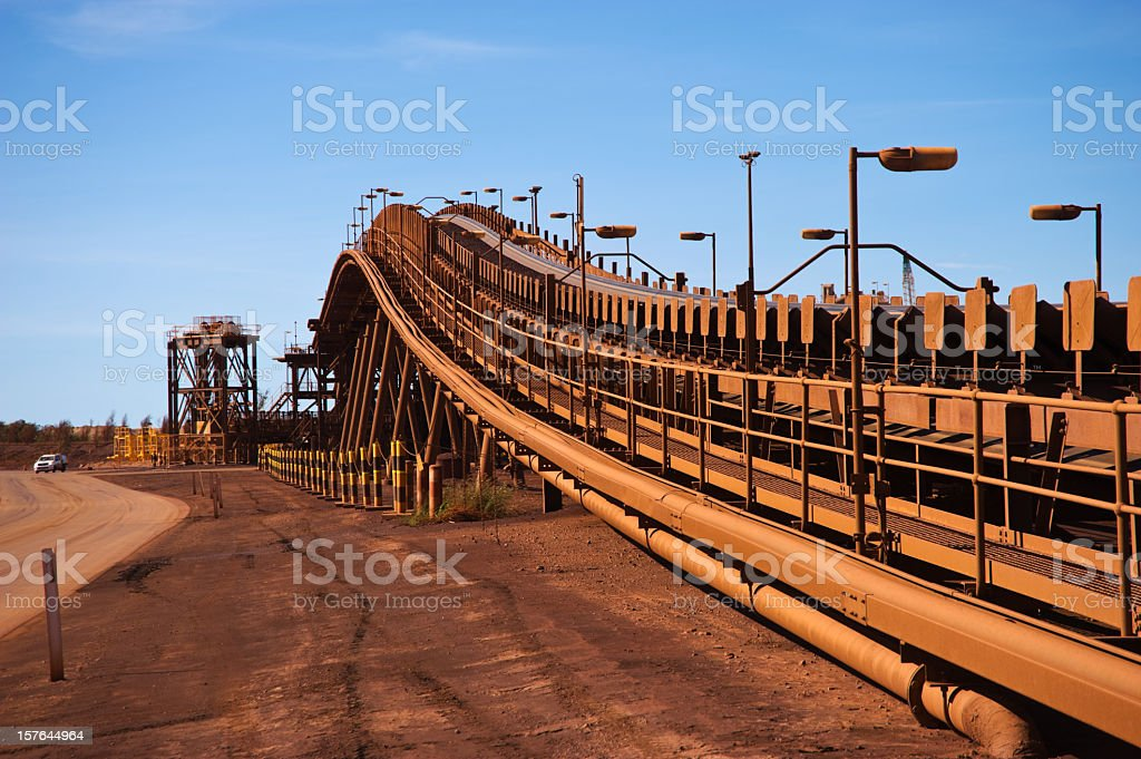 Red brown conveyor belts on the iron ore mine site stock photo