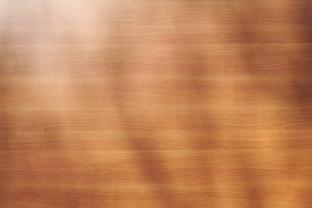 Red brown wooden background with soft shadows of branches stock photo