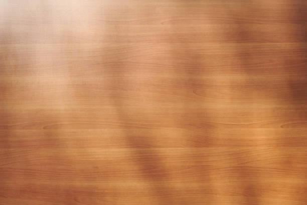 Rotbrauner Holzhintergrund mit weichen Zweigschatten – Foto