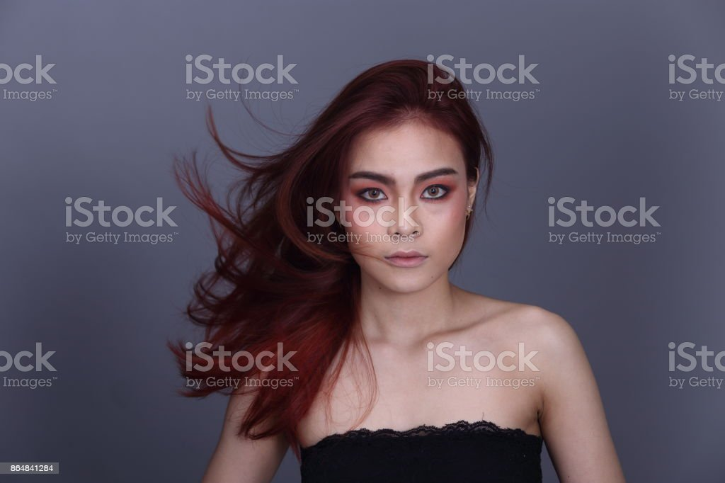 Make Up Stoel : Red brunette shinny hair style on asian make up woman stock photo