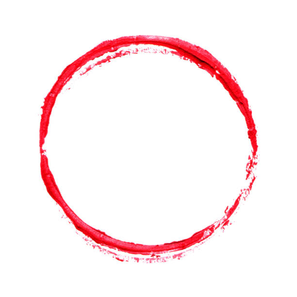Red brush stroke circle frame in lipstick isolated on white background stock photo