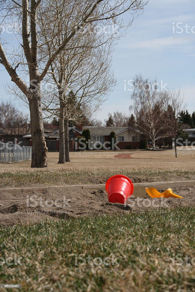 red bucket and scoop in sandbox at the playground royalty-free stock photo