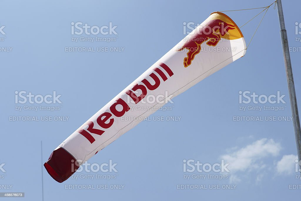 Red Bull windsock against blue sky stock photo