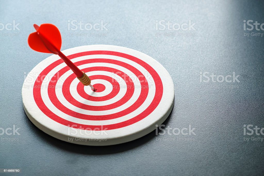 Red bullseye dart with red arrow hit center stock photo
