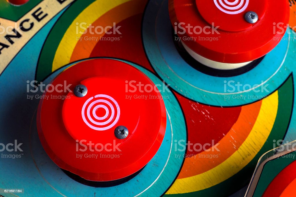 Red bumpers on a retro pinball machine stock photo