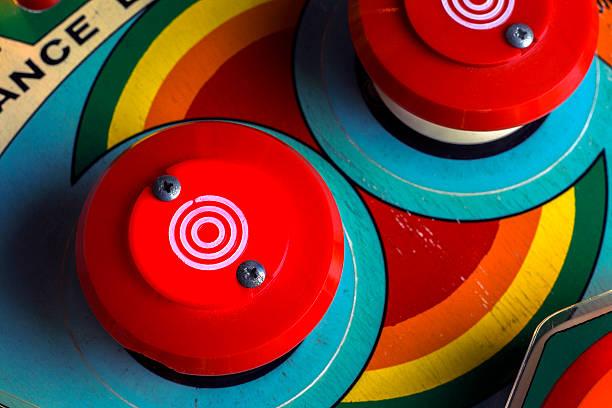 red bumpers on a retro pinball machine - pinball spielen stock-fotos und bilder