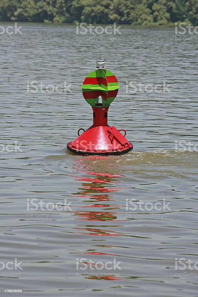 red buoy floating in the river royalty-free stock photo