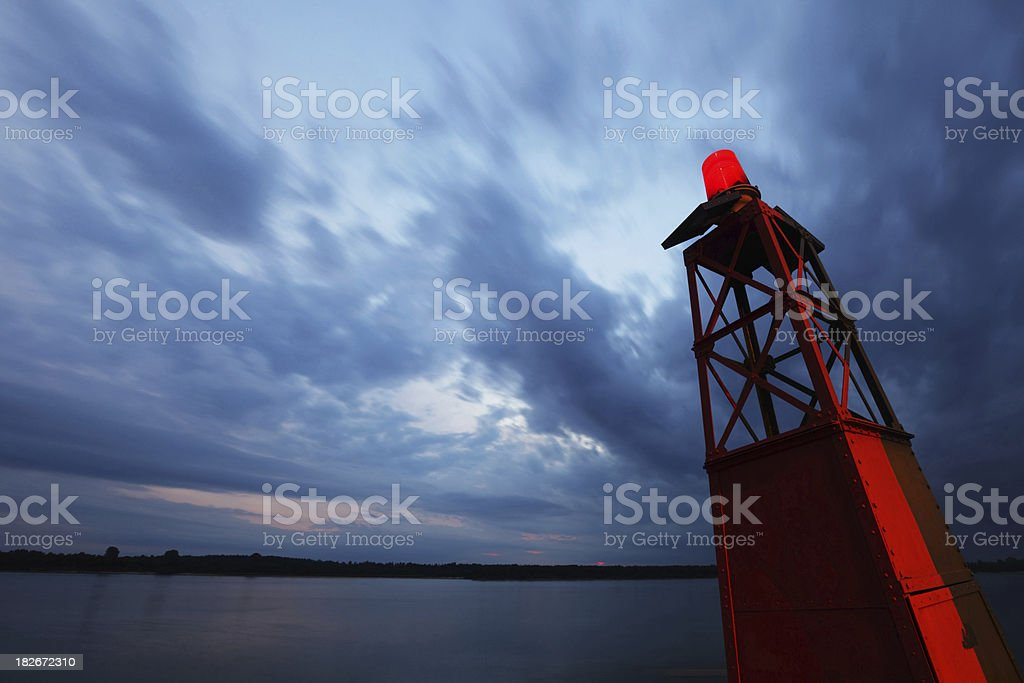 Red Buoy on Calm Water stock photo