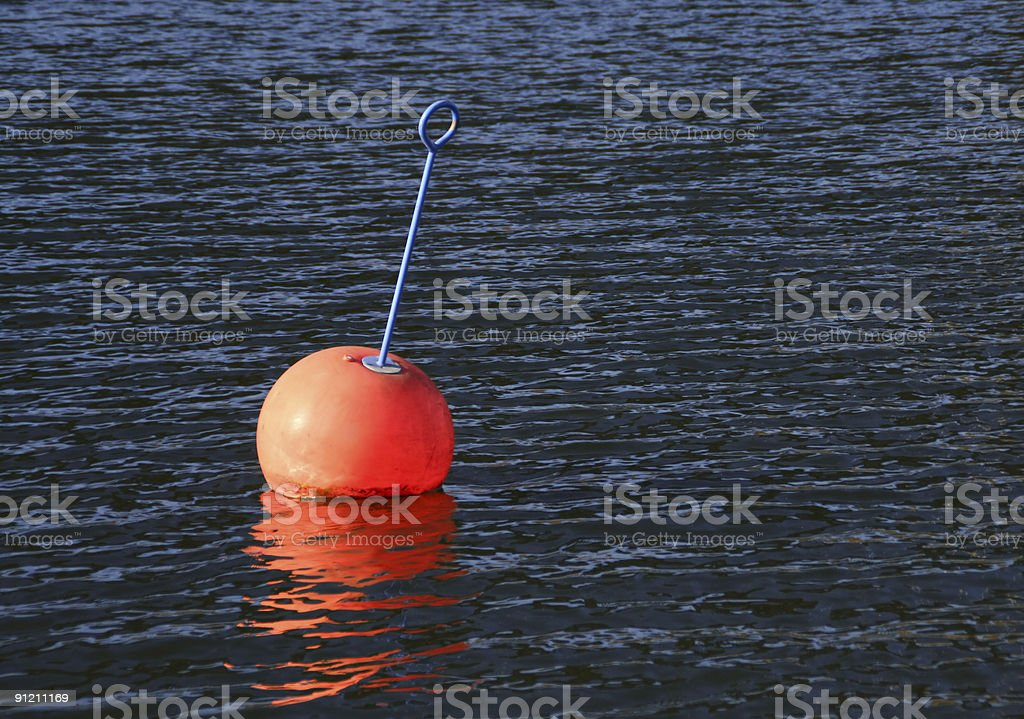 Red buoy on water royalty-free stock photo