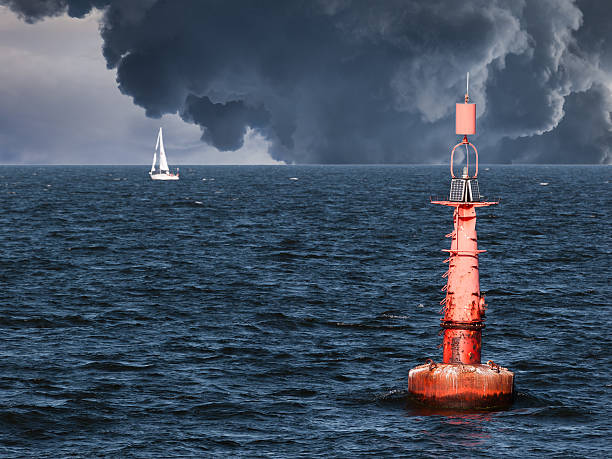 Red buoy Red buoy on water in a stormy day. buoy stock pictures, royalty-free photos & images