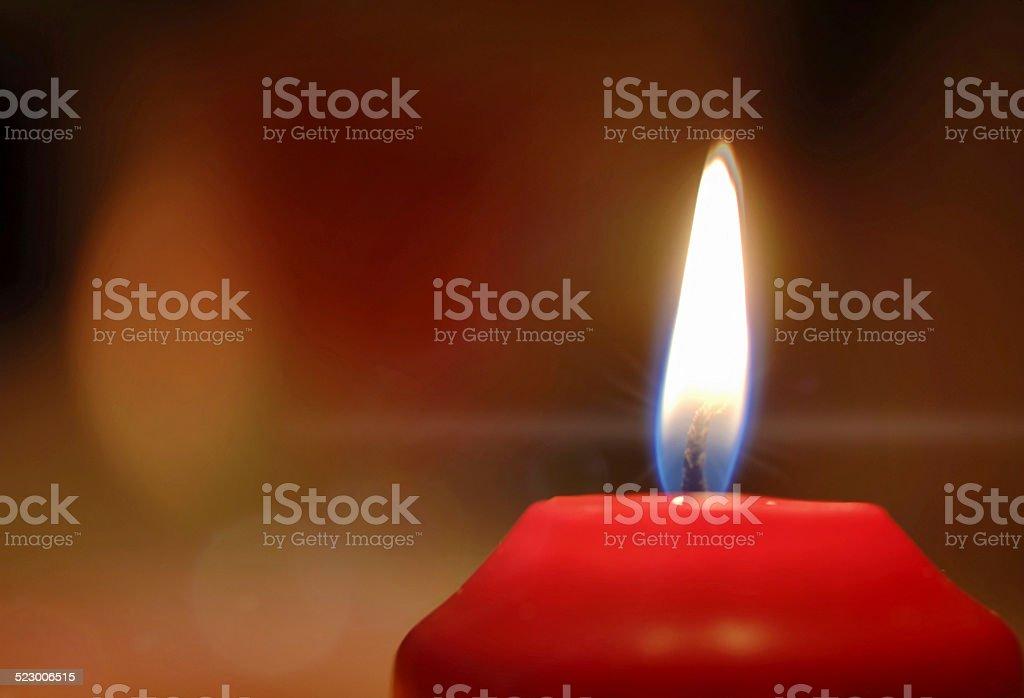 red burning candle Christmas stock photo