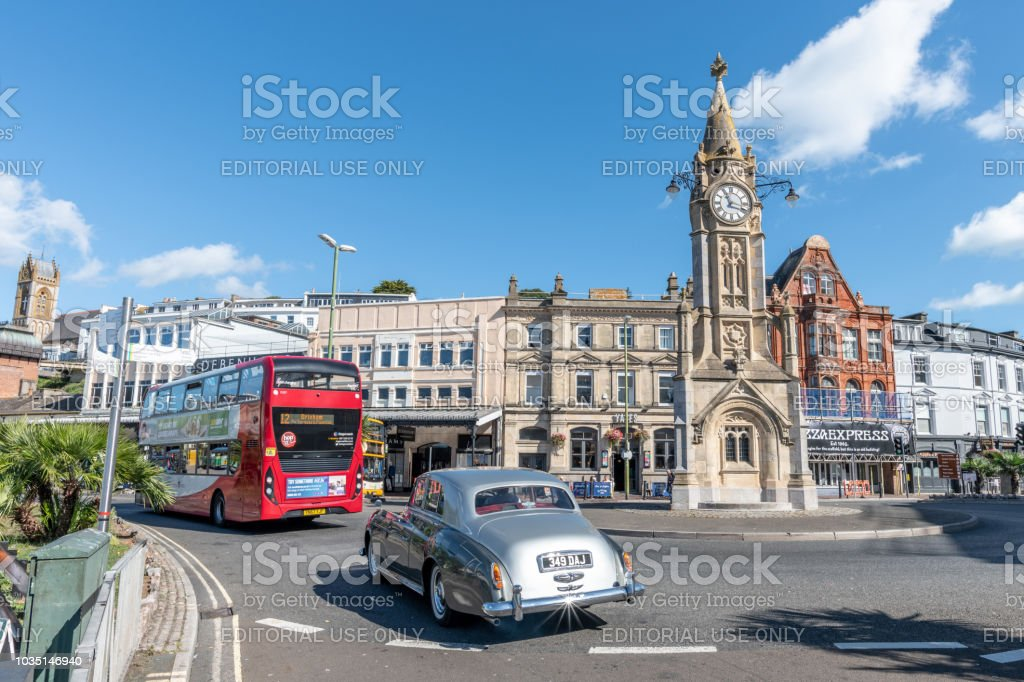 Red bus and classic car in Torquay, Devon stock photo
