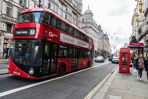 Red Bus Circulating In London United Kingdom Stock Photo - Download Image Now