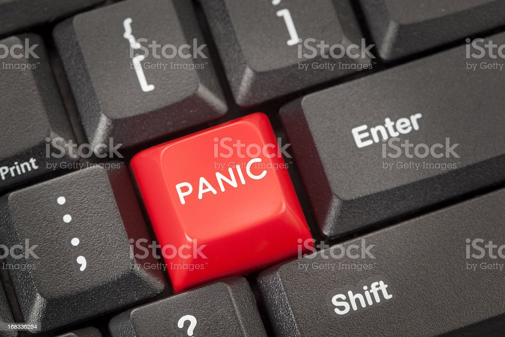 Red button marked panic on computer keyboard stock photo