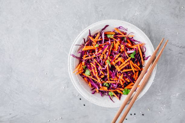red cabbage and carrot slaw salad with cilantro and sesame seeds - coleslaw stock pictures, royalty-free photos & images