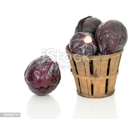 Red cabbage in a rustic wooden farm basket.