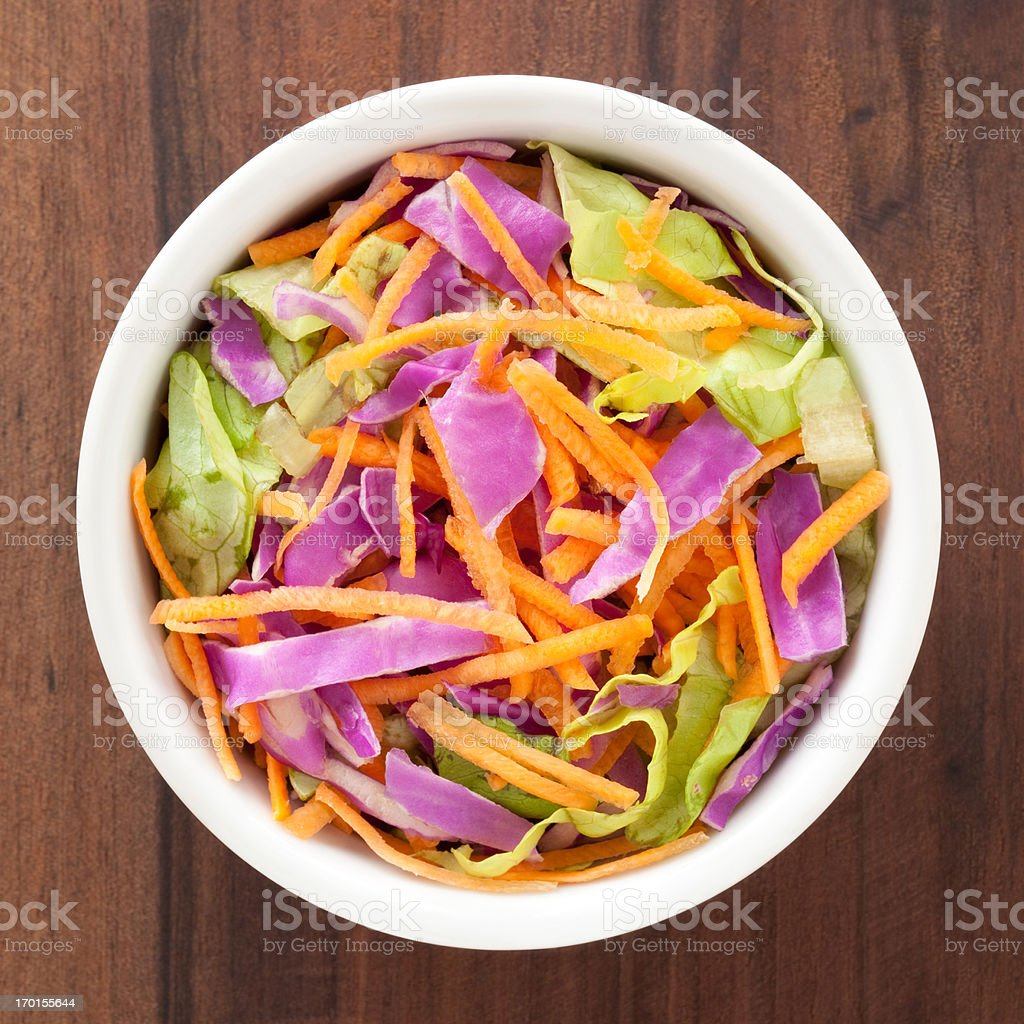 Red cabbage, lettuce and carrot salad stock photo
