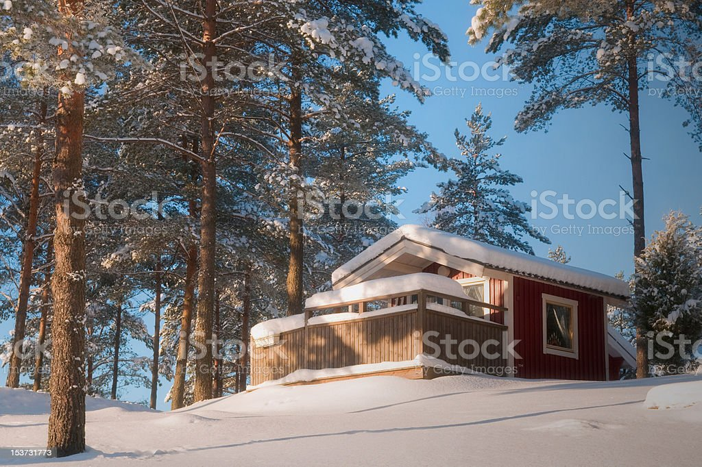 Red cabin in the winter royalty-free stock photo