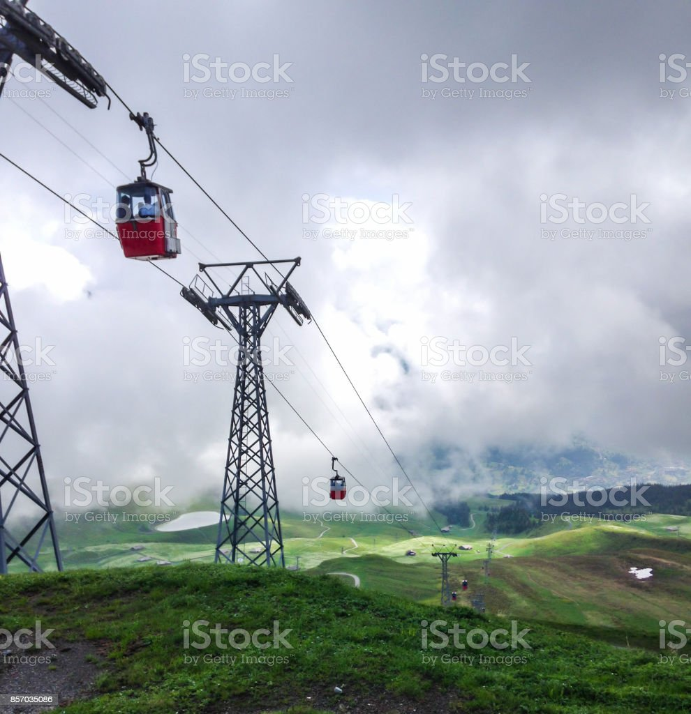 Red cable cabin down from Mannlichen with scenic view in direction to Grindelwald, Switzerland, Europe. stock photo