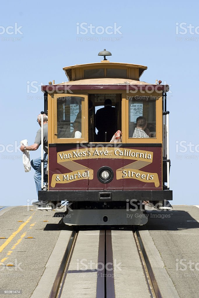 Red cable car going down the streets stock photo