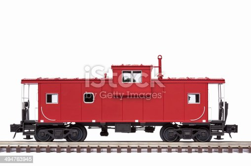 A red railroad caboose on track.