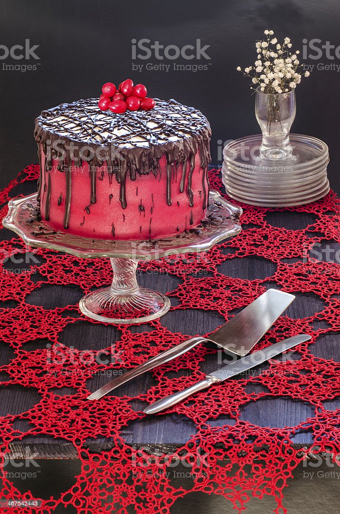 Red cake with poppy seeds, marzipan and chocolate stock photo