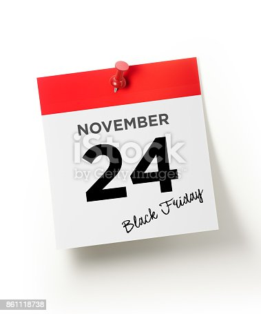 Red calendar pinned with a red push pin on white backgorund.  November 24 Black Friday writes on the calendar page. Vertical composition with copy space. November 24 Black Friday Concept.