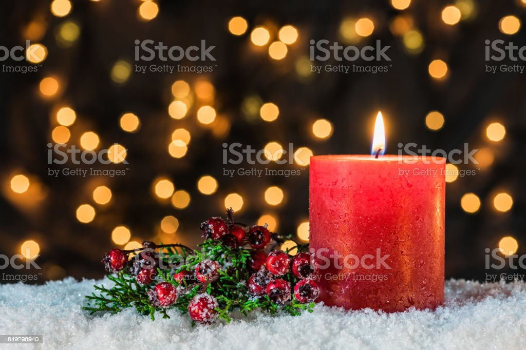 Burning candle for Advent and Christmas with decoration.