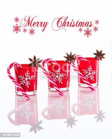 istock Red candle holders with crystal snowflakes and sugar canes 623681566