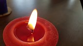 Two candles burn highlighted by contrasting blue and red lights.  Shallow Depth of Field adds softness to the image.