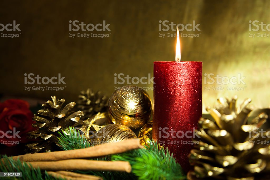 Red candle with golden background stock photo
