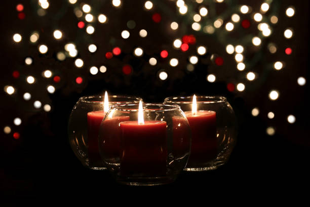 Red Candles and Lights red candles and small lights in the background jude beck stock pictures, royalty-free photos & images