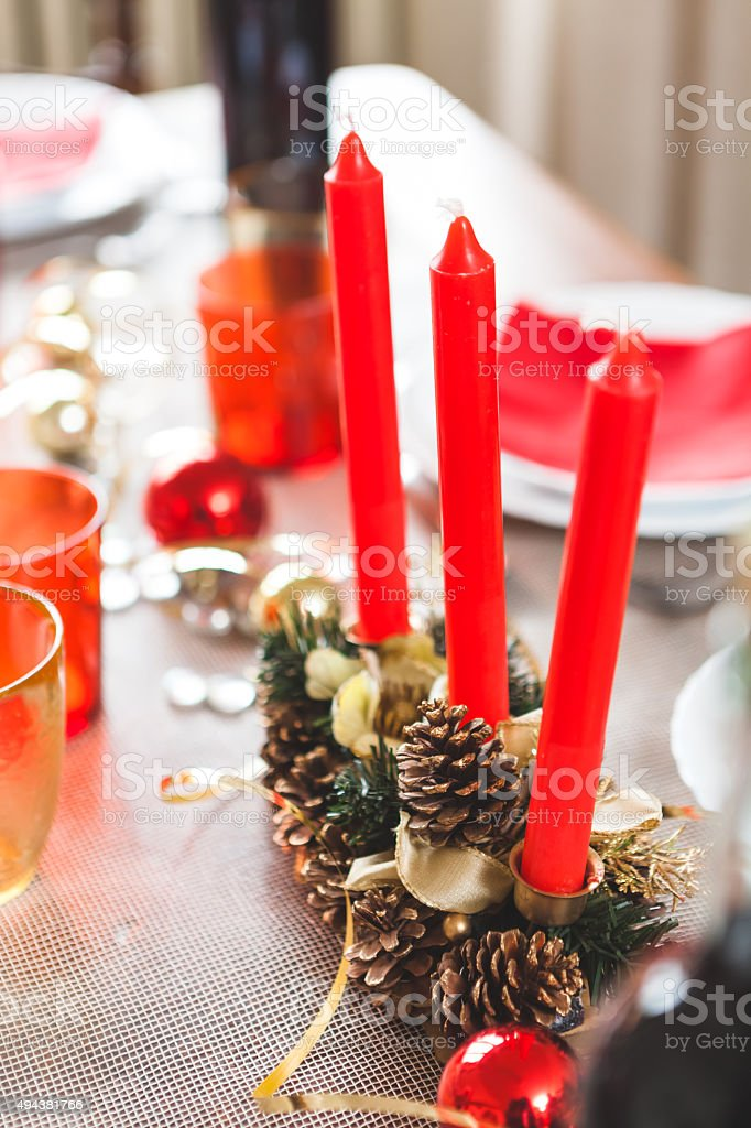 Red Candles at Christmas Dinner stock photo