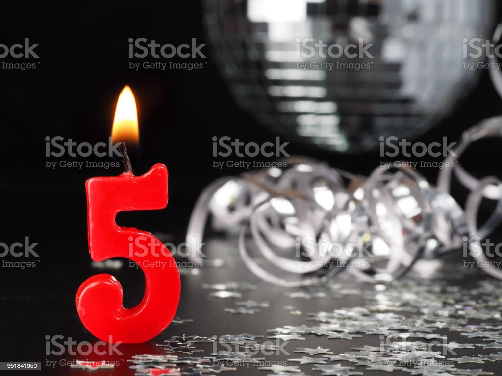 Red candles showing Nr. 5 stock photo