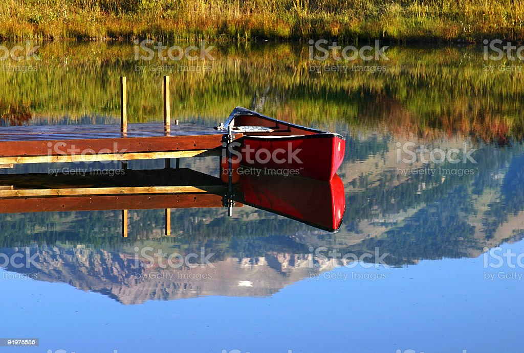 Red Canoe Reflections royalty-free stock photo