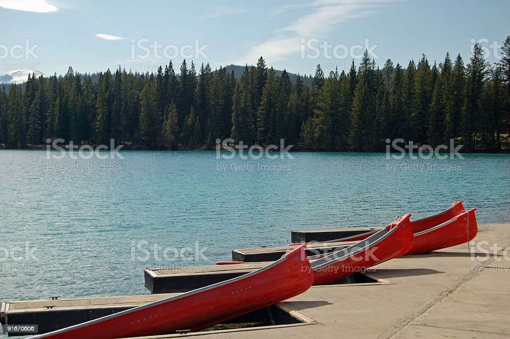 Red Canoes on Mountain Lake stock photo