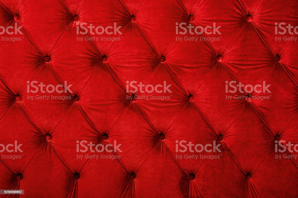 Red capitone tufted fabric upholstery texture stock photo