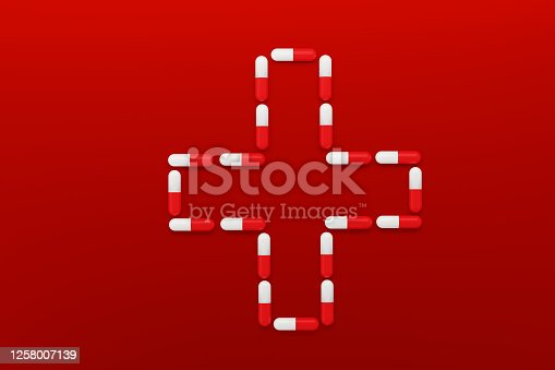 Red capsules on red background. Medicines for blood healthy concept. 3d illustration.