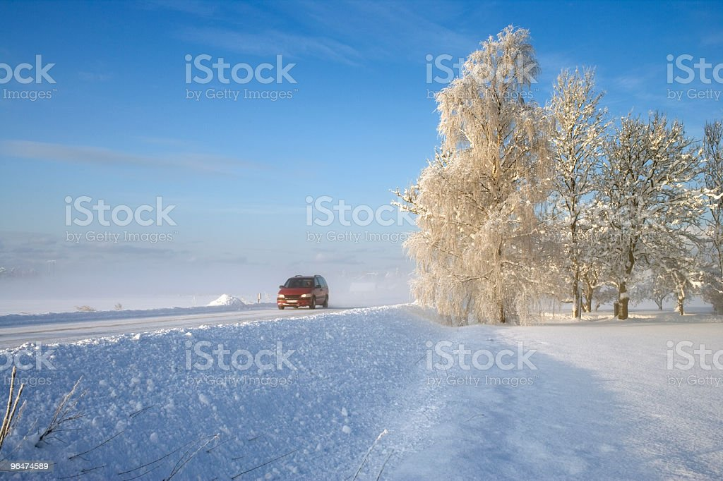 Red car at winter road royalty-free stock photo