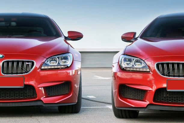 Red car BMW M6 in the city stock photo