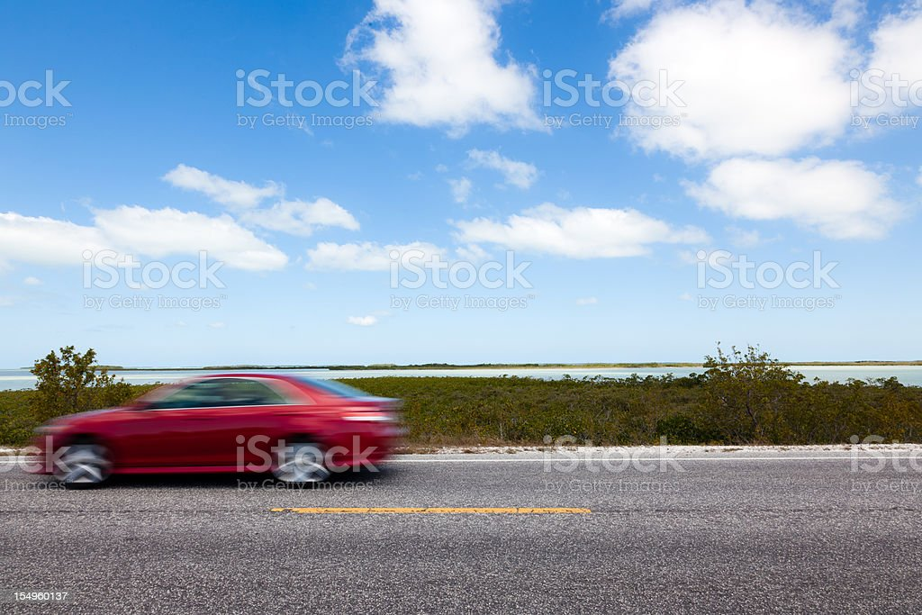Red Car Driving in the Florida Keys stock photo