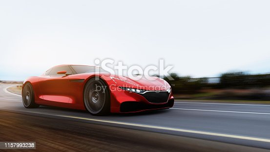 918555756 istock photo red car driving on a mountain road 1157993238