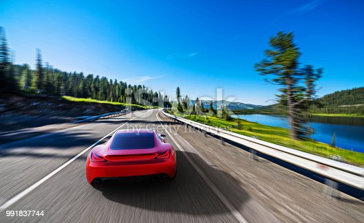 istock red car driving on a mountain road 991837744
