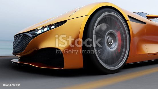 istock red car driving on a road by sea 1041476938